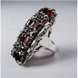 A Sterling Silver, Garnet and Marcasite Ring.
