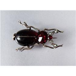 A Low kt Gold, Garnet and Pearl Beetle Brooch.