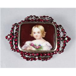 A Garnet and Porcelain Brooch.