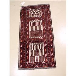 A Baluch Wool Rug.