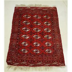A Bokhara Wool Rug.