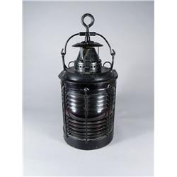 A Vintage Patinated Metal and Glass Port Side Nautical Light.