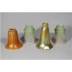 A Group of Four Glass Shades.