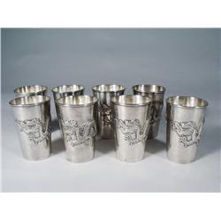 A Set of 8 Chinese Silver Dragon Cups.