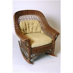A mid century modern Heywood Wakefield wicker rocking chair in original finish.