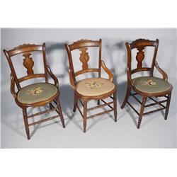 A Group of Three Victorian Walnut and Mahogany Side Chairs with Needlepoint Seats.