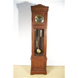 A 20th Century Pennsylvania Dutch Style Walnut Tall Case Clock.