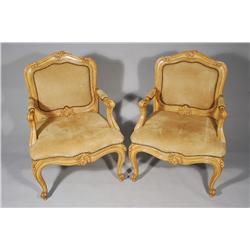 A Pair of French Provincial Style Painted Fauteuils with Faux Leather Upholstery.