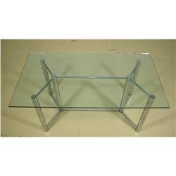A Contemporary Chrome and Glass Table.