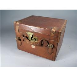 A Vintage Leather and Brass Hat Box.