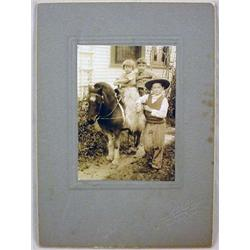 MOUNTED PICTURE OF KIDS ON PONY - 1 W/ WOOLY CHAPS