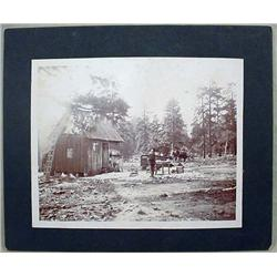 ANTIQUE MOUNTED PHOTO OF MAN W/ RIFLE STANDING OUT