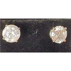 PAIR OF 14K WHITE GOLD AND DIAMOND SOLITAIRE EARRI