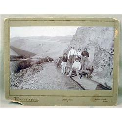 C. 1880'S MOUNTED PHOTO OF MEN ON RAILROAD CARTS -