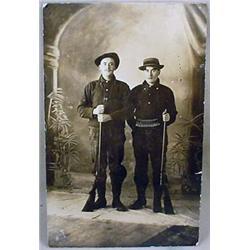 C. 1909 RPPC REAL PHOTO POSTCARD OF 2 MEN W/ SHOTG