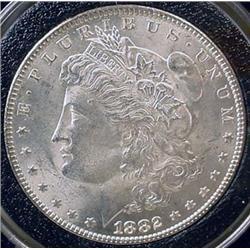 1882-P MORGAN SILVER DOLLAR - UNC.