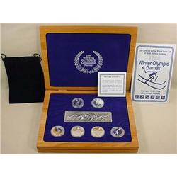1994 OLYMPICS SILVER COLLECTION - 6 COINS AND MEDA