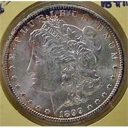 1899-O MORGAN SILVER DOLLAR - UNC.