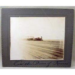 C. 1900'S MOUNTED PHOTO OF RAILROAD TRAIN ON PLAIN