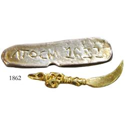 Lot of 2 replica items: a small, gold, sword-shaped toothpick made to look like ones found on the wr