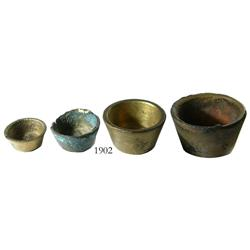 Set of 4 brass nested weights.