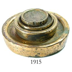 Set of 4 brass disk-type weights.