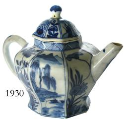 Blue-on-white Chinese porcelain teapot with lid, 8-paneled design and shape.