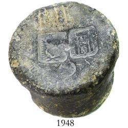 Cylindrical lead weight with bold stamps on top.