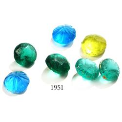 Lot of 7 small glass beads.