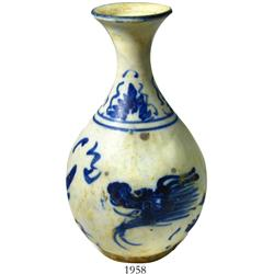 Small, blue-on-white Chinese porcelain vase, dragon motif.