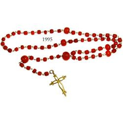 Gold and red-coral rosary/cross from colonial Peru (1700s).