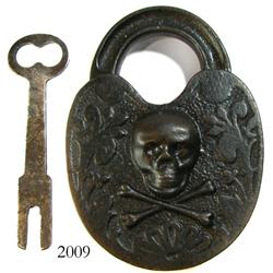 Modern reproduction iron skull-and-crossbones padlock and key.