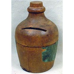 C. 1890'S MINIATURE WOODEN JUG ADVERTISING BANK -