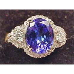 14K WHITE GOLD LADIES DIAMOND AND TANZANITE RING -