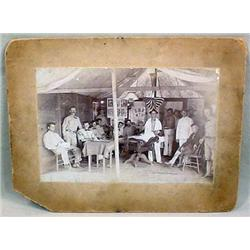 ANTIQUE MOUNTED PHOTO OF EARLY MILITARY BARBER SHO