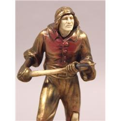 A Patinated White Metal and Faux Ivory Figure of a Soldier, Mounted on a Carved Marble Dish.