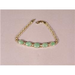 A 14 kt Yellow Gold, Jade and Diamond Bracelet,