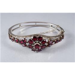 A Gold Plated, Garnet and Pearl Bracelet.