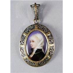 A Silver and Low kt Gold Porcelain Brooch.