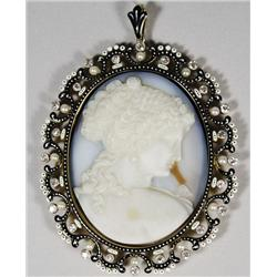 A Carved Russian Agate Cameo with 18 kt Yellow Gold, Diamond and Pearl Frame with Black and White En