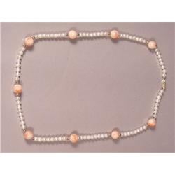 A Coral and Cultured Pearl Necklace with 14 kt gold balls,