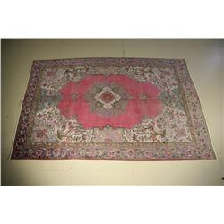 A Tabriz Wool Rug.
