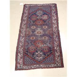 An Antique Persian Wool Rug.