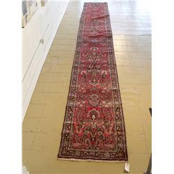 An Antique Persian Wool Runner.
