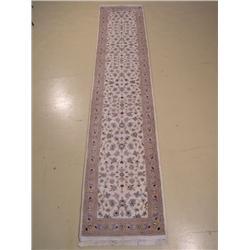 An Indo Persian Sarouk Wool Rug.