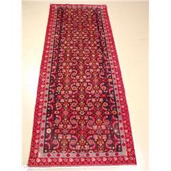 A Persian Azari Wool Rug.
