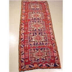 A Persian Serab Wool Rug.