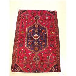 A Persian Hamadan Wool Rug.