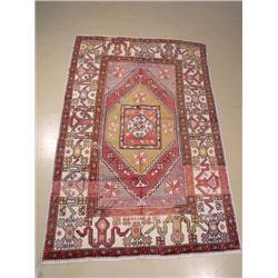 An Antique Turkish Ushak Wool Rug.