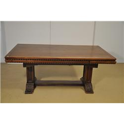 A Gothic Revival Style Mahogany Trestle Table with Parquetry Inlay.